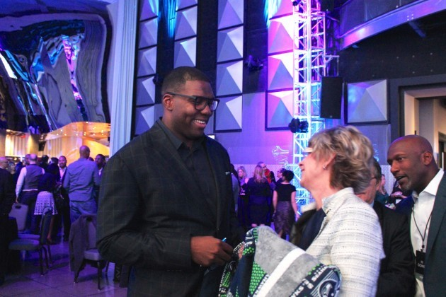 Seahawks lineman Russell Okung shares a laugh at his foundation's launch at the EMP in Seattle.
