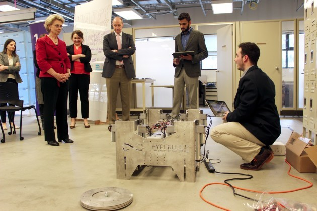 University of Washington engineering students show off their conceptual Hyperloop transportation system to Challenge Seattle CEO Christine Gregoire.
