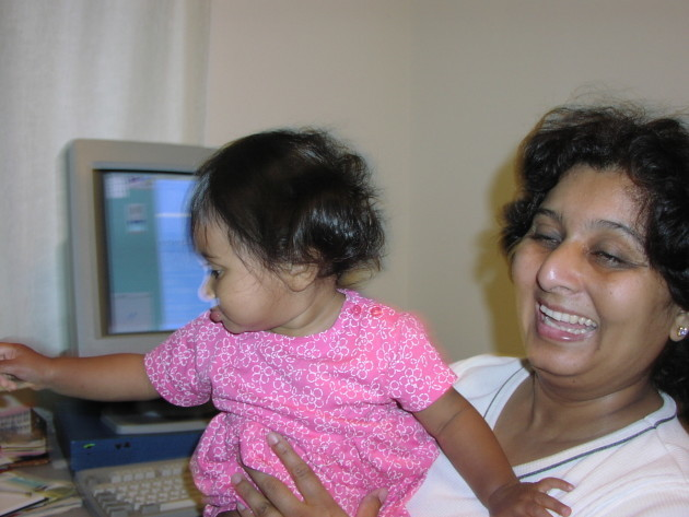 Thekkath's daughter Divya, as a toddler, reaching for mom's mouse.