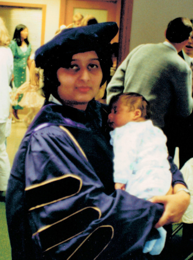 Radhika Thekkath holding her 2-month-old son at a graduation party in 1995 celebrating her Ph.D. in computer science.