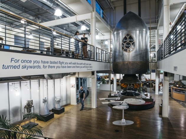 The reception area at Blue Origin's headquarters features a model of the Starship Enterprise and a Jules Verne-inspired rocket sculpture. (Credit: Blue Origin)