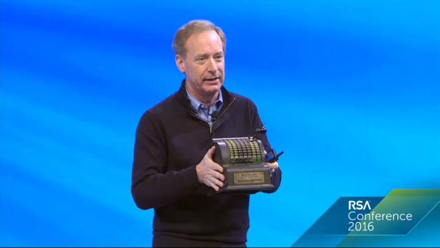 Microsoft president Brad Smith brought an adding machine on stage to illustrate the age of laws affecting our current technology.