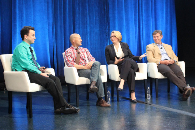 GeekWire's Taylor Soper moderates a panel at Microsoft Envision in New Orleans with AEG Chief Revenue Officer Todd Goldstein; NFL CIO Michelle McKenna-Doyle; and Sensoria CEO Davide Vigano.