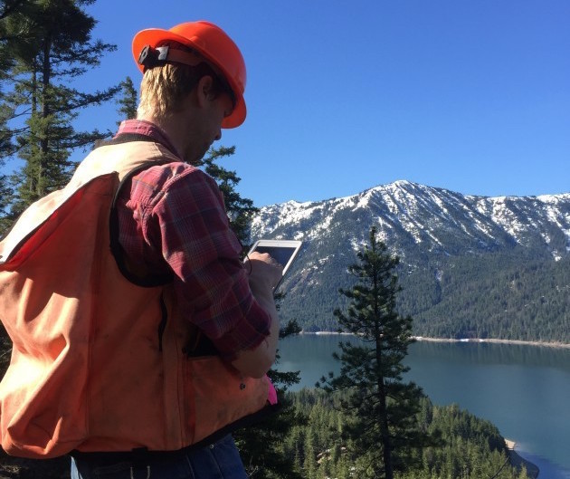 Brian Mize, a forester with The Nature Conservancy, in the Central Cascades using an app in the field to assist in managing forestland. (The Nature Conservancy)