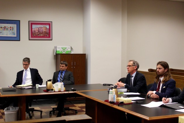 ucas Price (second from left) and his brother, Dan Price (far right), at a previous court hearing. (GeekWire File Photo)