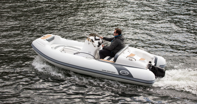Demonstrating a Pure Outboard prototype. Image via Pure Watercraft