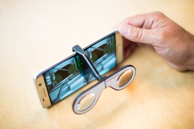 By using a phone, Visual Vocal has a portable tool for VR viewing. And because it doesn't completely block out the world outside, users are less likely to get the motion sickness related to standard VR setups. Image via Visual Vocal.