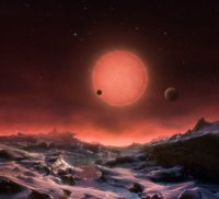 View of ultracool dwarf star with planets