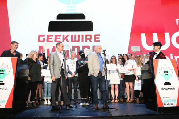 Arivale CEO Clayton Lewis and co-founder Lee Hood accept the award for Startup of the Year.