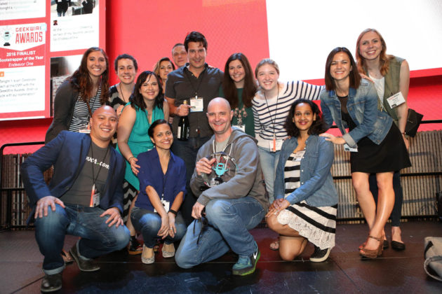 Rover employees celebrate with CEO Aaron Easterly after his CEO of the Year award win at the 2016 GeekWire Awards.
