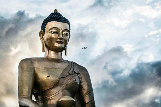 Matternet flies a drone in Bhutan, over the shoulder of a Buddah. (Matternet)