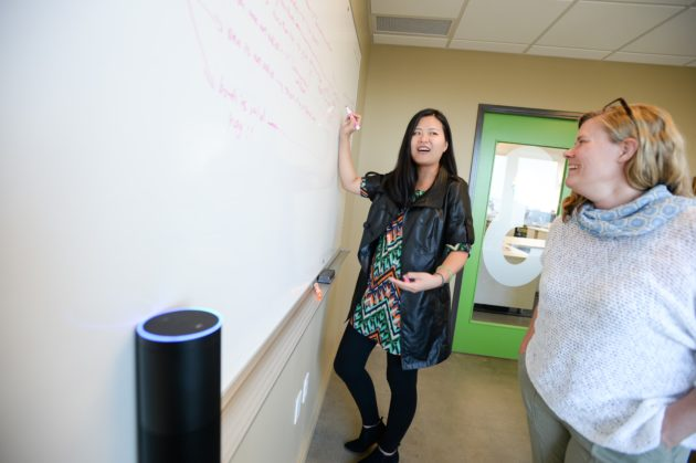 UX Developer Li Li (left) and Principal UX Researcher Siri Mehus work on Alexa's ferry skill.