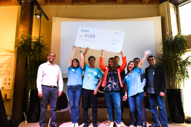 Winning company Hubb hold up their $155,000 investment check from the Seattle Angel Conference