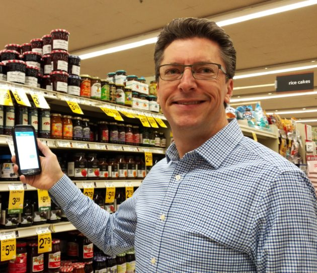Observa CEO Hugh Holman using the company's app in a grocery store. Image via Observa.