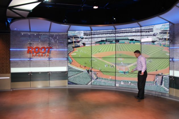 Root Sports Northwest Executive Director Jon Bradford shows how anchors can move around the studio.