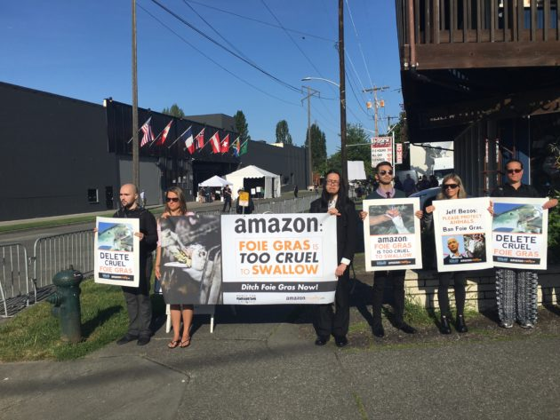 Protestors gather outside of Amazon's shareholders meeting Tuesday.