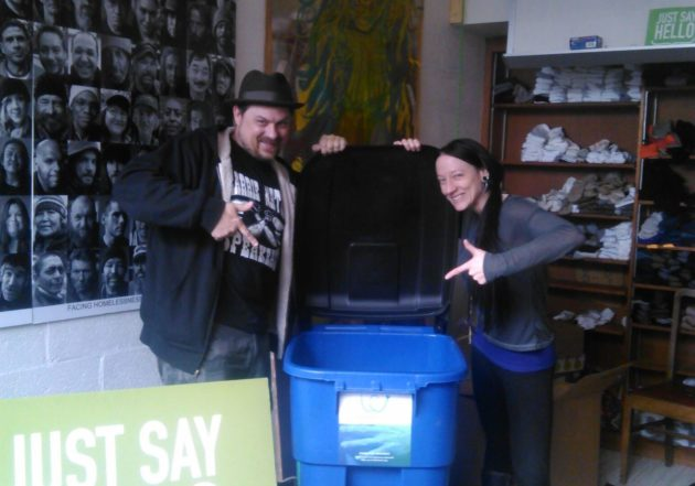 WeCount co-founder Graham Pruss with Sarah Steilen, operations manager for Facing Homelessness, showing off one of the donation bins for WeCount.(WeCount)