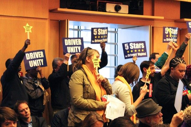 For-hire drivers gather at a Seattle City Council meeting in December in support of a new law that paves the way for drivers to unionize. (GeekWire File Photo)