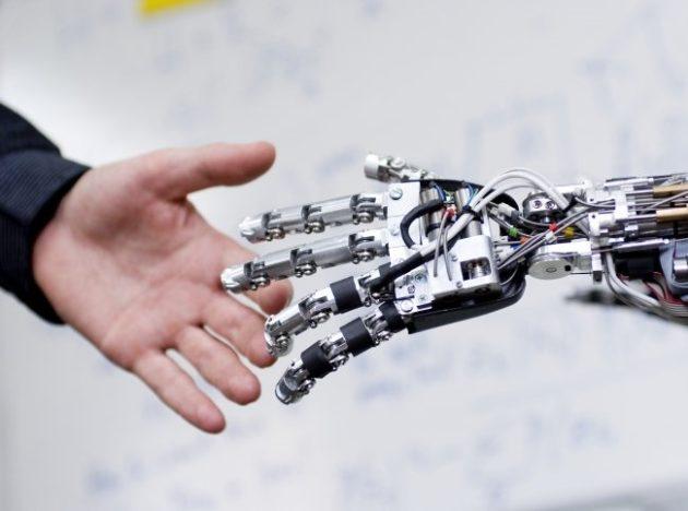 Human and AI machine hands