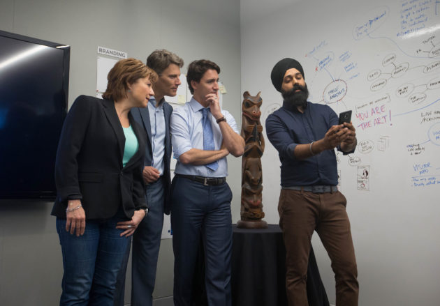 Preet Mangat, Senior Program Manager Microsoft Canada, demonstrates City Hacks with Rt. Hon. Justin Trudeau, Prime Minister of Canada (center), the Hon. Christy Clark, the Premier of British Columbia and Mayor Gregor Robertson, for the City of Vancouver at the Microsoft Canada Excellence Centre.