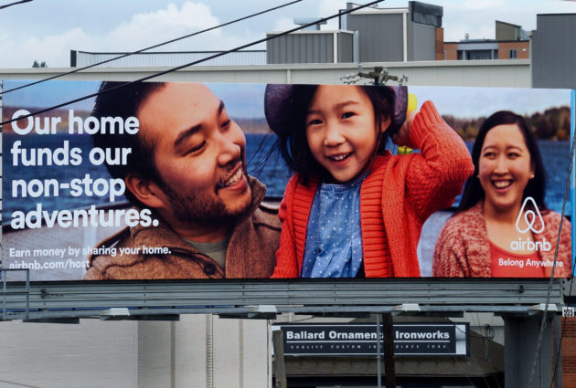 An Airbnb billboard in Seattle. (GeekWire Photo).