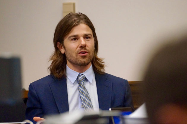Gravity Payments CEO Dan Price testifies in court during the civil trial. (GeekWire File Photo)