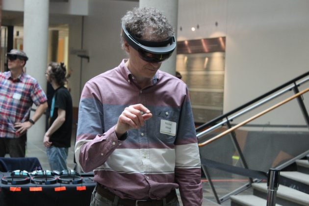Oculus Chief Scientist Michael Abrash tests out student-made HoloLens applications.