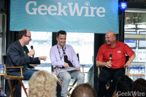 GeekWire's Todd Bishop (left) and Taylor Soper interview Los Angeles Clippers owner Steve Ballmer at the GeekWire Sports Tech Summit