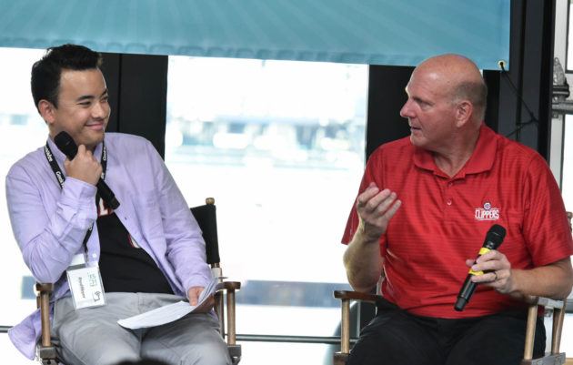 GeekWire Reporter Taylor Soper and L.A. Clippers owner Steve Ballmer on stage at the Sports Tech Summit.