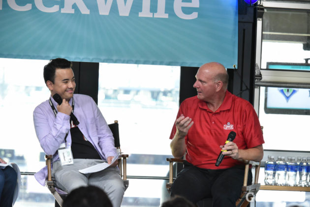 GeekWire Reporter Taylor Soper and L.A. Clippers owner Steve Ballmer on stage at the the Sports Tech Summit.
