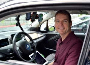Scott Baker in one of INRIX's BMW i3 test cars.