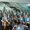 Zillow employees get ready for an outing at Safeco Field.