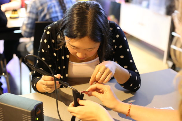 Kathryn Orr, a high school junior from Lake Stevens High School, practicing her soldering at the Girls Who Code Summer Immersion Program.