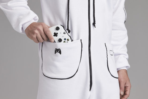 Not content with offering the ultimate entertainment and gaming access via the new Xbox One S console, available in 500GB and 1TB versions from today, the team at Xbox Australia has now turned its hand to the world of fashion design, working with some of the country's biggest film, TV, gaming and sports fans to release their first collection known simply as the 'Xbox Onesie'. With custom features including enlarged pockets to fit controllers, forearm grips for those edge of your seat moments and an XL hood to accommodate headsets, the Xbox Onesie comes with everything an entertainment enthusiast could need when streaming a favourite TV show or film, watching sports or embarking on the ultimate gaming session. Pictured: The Xbox Onesie comes complete with a custom designed pocket big enough to fit your Xbox controller.