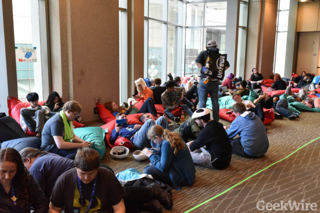 PAX attendees take a break on bean bag chairs.