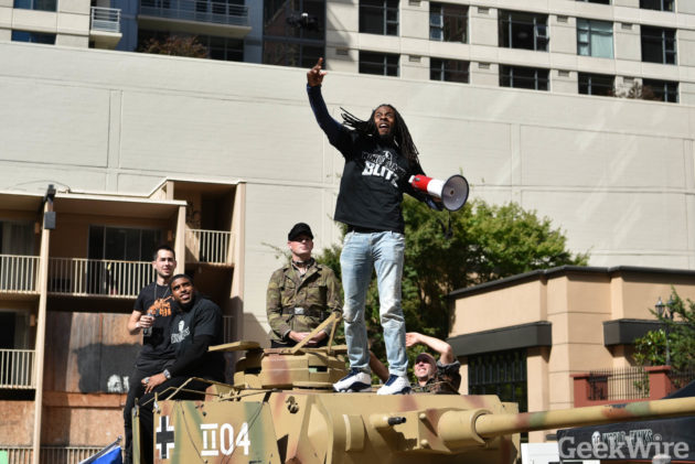 Richard Sherman tosses out t-shirts from aboard a Panzer tank (Photo by Kevin Lisota)