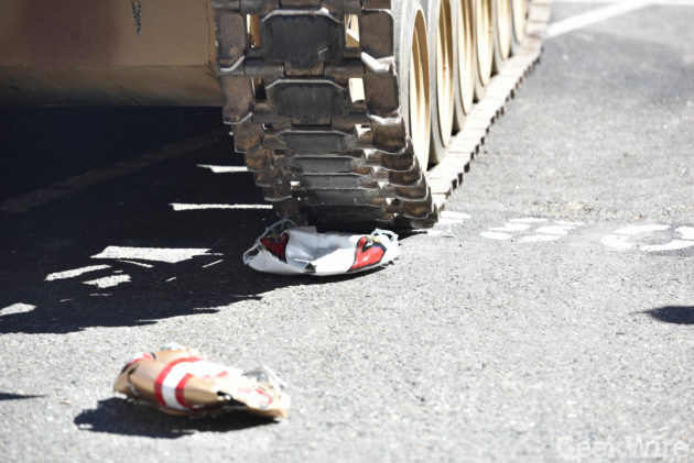 49er's and Cardinal's helmets after being crushed by a tank (Photo by Kevin Lisota)