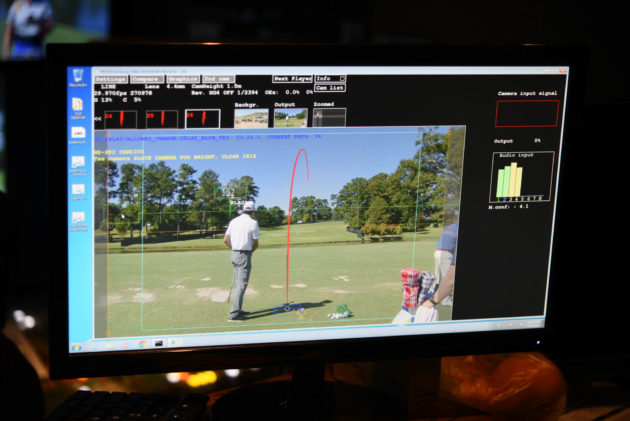 PGA Tour employees analyze Protracer data inside the graphics broadcast truck.