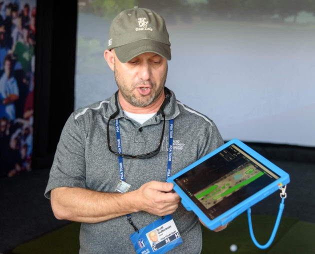 Scott Gutterman, vice president of operations and product development for PGA Tour Digital, explains how the PGA Tour is using the Microsoft Surface to track shots and provide data to fans and broadcasters. (GeekWire photos / Kevin Lisota)
