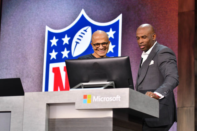 Microsoft CEO Satya Nadella teaches NFL legend Deion Sanders about a new fantasy football bot.