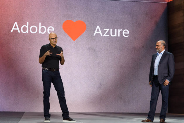 Microsoft CEO Satya Nadella and Adobe CEO Shantanu Narayen on stage at Microsoft Ignite in Atlanta to talk about their latest deal. Photo by GeekWire / Kevin Lisota.