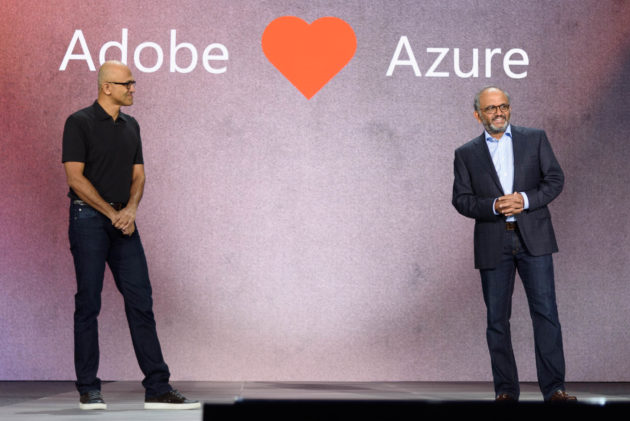 Microsoft CEO Satya Nadella and Adobe CEO Shantanu Narayen announce partnership at Microsoft Ignite (GeekWire Photo/Kevin Lisota)