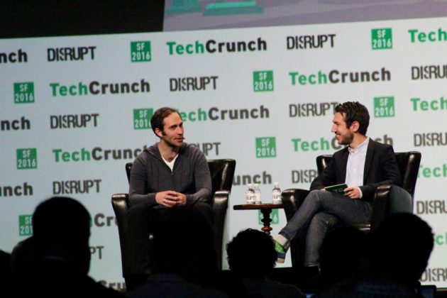 Twitch CEO Emmett Shear (left) speaks at TechCrunch Disrupt in San Francisco on Wednesday. (GeekWire photos)