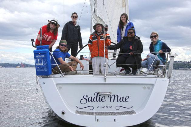 Justin Beals and his team on his sailboat Sadie Mae.