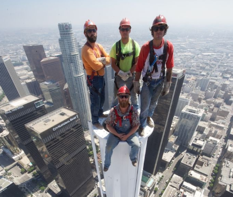 Stomach Turning Photo Features Construction Workers Atop