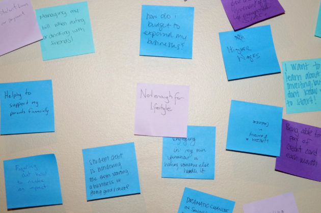 Guests at Millennial Weekend were asked to write their top financial struggles on post-its.