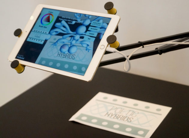 The iPad displays a 3D 'sculpture' when the Poetic Hybrids sign is placed beneath the camera.