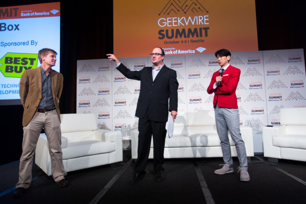 GeekWire co-founders John Cook and Todd Bishop with GeekWire Chairman Jonathan Sposato.