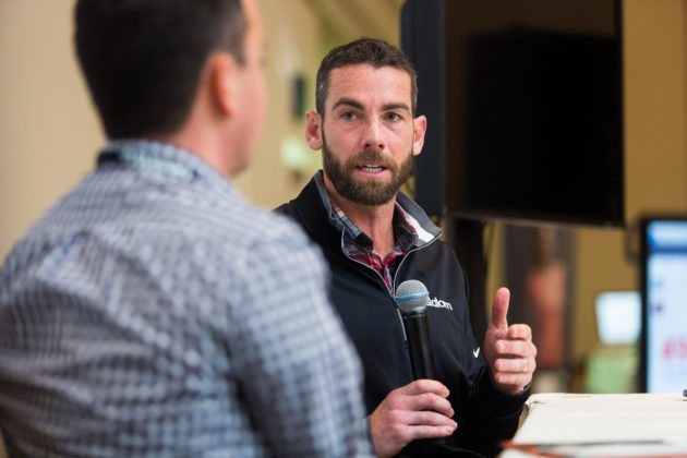 Sounders defender Zach Scott speaks on stage at the 2016 GeekWire Summit. Photo by Dan DeLong for GeekWire