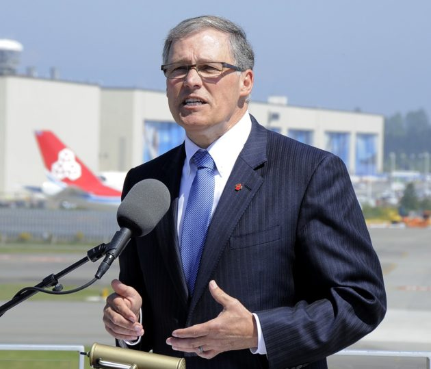 "Washington Gov. Jay Inslee, shown here with Boeing's Everett plant in the background, says he intends to keep the state on the ""cutting edge"" in aerospace."